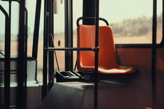 Sit near the front of the bus