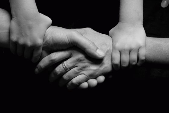 Child and Parents Hands Together